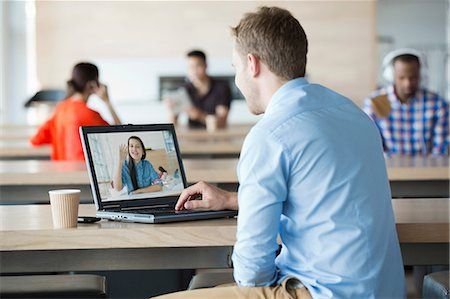 Young man using laptop to have video call with girlfriend Stock Photo - Premium Royalty-Free, Code: 614-06169602