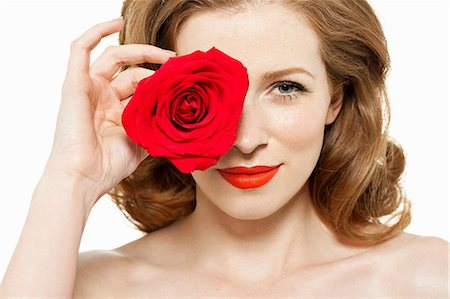rose - Woman covering eye with red rose Stock Photo - Premium Royalty-Free, Code: 614-06311595