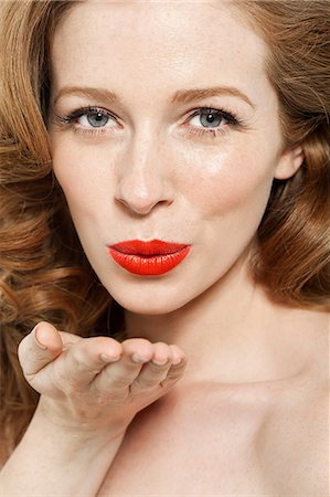 Woman blowing a kiss Stock Photo - Premium Royalty-Free, Code: 614-06311592
