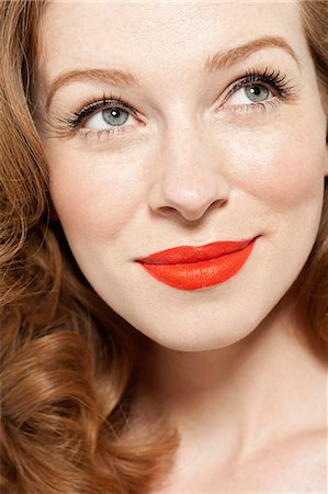 red - Woman wearing red lipstick Stock Photo - Premium Royalty-Free, Code: 614-06311603