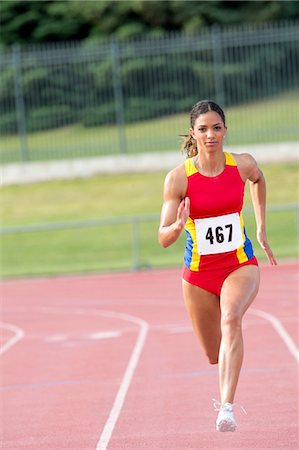 sprint - Female athlete running on track Stock Photo - Premium Royalty-Free, Code: 614-06311635