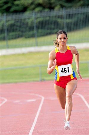 sprint - Female athlete running on track Stock Photo - Premium Royalty-Free, Code: 614-06311635