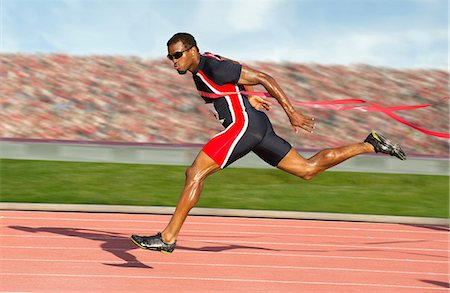 sprint - Runner crossing the finish line Stock Photo - Premium Royalty-Free, Code: 614-06311639
