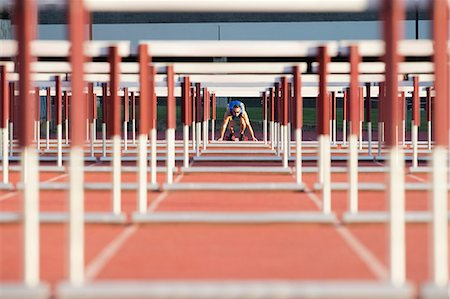 Male hurdler at starting line Stock Photo - Premium Royalty-Free, Code: 614-06311632