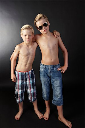 preteen boy shirtless - Brothers with arms around each other Stock Photo - Premium Royalty-Free, Code: 614-06311724