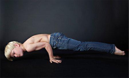 Boy doing push up Stock Photo - Premium Royalty-Free, Code: 614-06311722