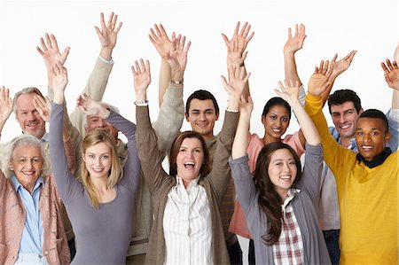 Group of people with arms raised Stock Photo - Premium Royalty-Free, Code: 614-06311767