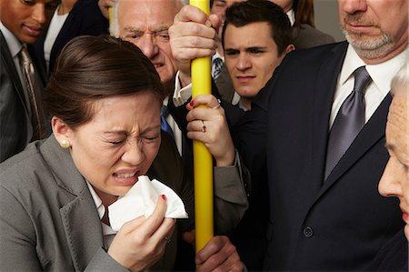 people coughing or sneezing - Businesswoman sneezing on subway train Stock Photo - Premium Royalty-Free, Code: 614-06311769