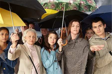 people with umbrellas in the rain - Group of people with umbrellas Stock Photo - Premium Royalty-Free, Code: 614-06311774