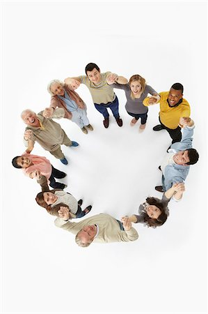 Group of people in a circle, high angle view Stock Photo - Premium Royalty-Free, Code: 614-06311775