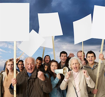 Group of angry protesters holding blank banners Stock Photo - Premium Royalty-Free, Code: 614-06311805