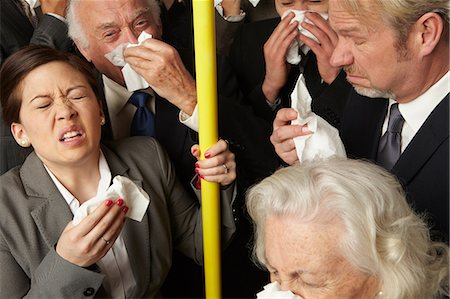 people coughing or sneezing - Businesspeople sneezing on subway train Stock Photo - Premium Royalty-Free, Code: 614-06311801