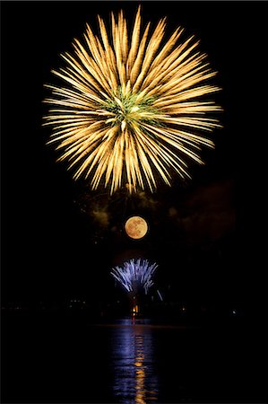 fireworks colored picture - Firework in the sky above the moon Stock Photo - Premium Royalty-Free, Code: 614-06311852