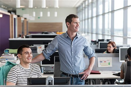 Two colleagues in office interior Stock Photo - Premium Royalty-Free, Code: 614-06311909