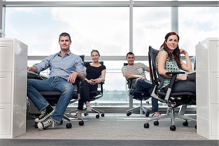 Creative business people sitting at workstations Stock Photo - Premium Royalty-Free, Code: 614-06311911