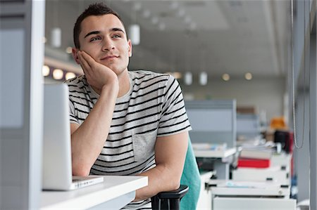 Man daydreaming at desk Stock Photo - Premium Royalty-Free, Code: 614-06311928