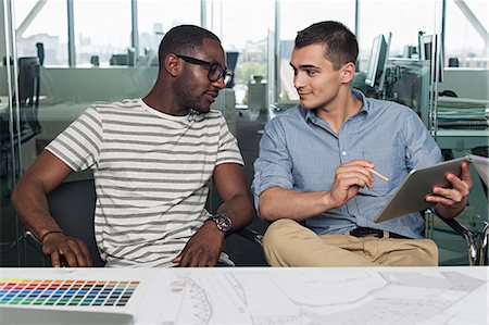 Two men with digital tablet Stock Photo - Premium Royalty-Free, Code: 614-06311956