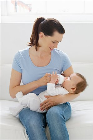 Mother bottle feeding baby Stock Photo - Premium Royalty-Free, Code: 614-06311998