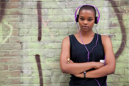 Young woman wearing headphones Stock Photo - Premium Royalty-Free, Code: 614-06311993