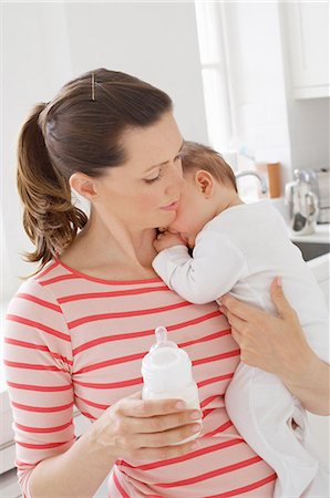 formula - Mother holding baby girl and bottle Stock Photo - Premium Royalty-Free, Code: 614-06312022