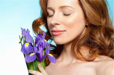 smelling - Woman smelling purple flowers Stock Photo - Premium Royalty-Free, Code: 614-06312043