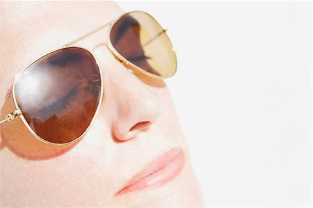 dark glasses - Woman's face in sunlight Stock Photo - Premium Royalty-Free, Code: 614-06335967