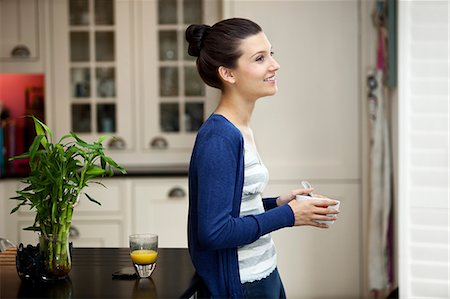 Young woman eating breakfast Stock Photo - Premium Royalty-Free, Code: 614-06335987