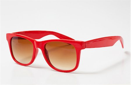 dark glasses - Pair of red sunglasses Stock Photo - Premium Royalty-Free, Code: 614-06336011