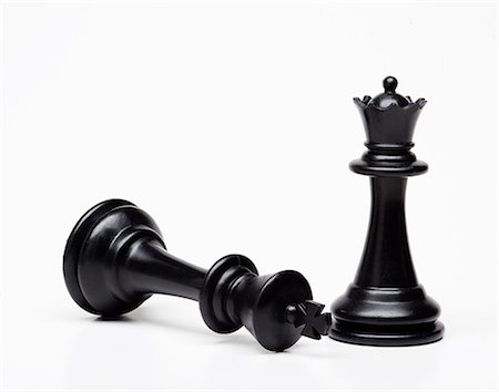 pair - Chess queen and king piece, king fallen Stock Photo - Premium Royalty-Free, Code: 614-06336027