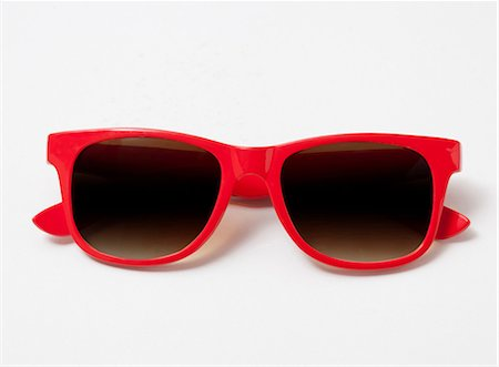 dark glasses - Pair of red sunglasses Stock Photo - Premium Royalty-Free, Code: 614-06336028
