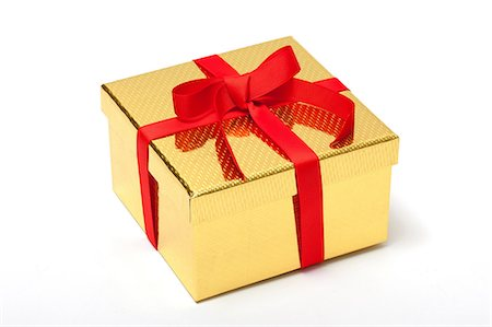 Golden gift box with red ribbon Stock Photo - Premium Royalty-Free, Code: 614-06336105