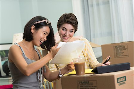 renting - Two young women looking at paperwork for new apartment Stock Photo - Premium Royalty-Free, Code: 614-06336113