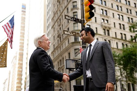 Businessmen shaking hands on Wall Street, New York City Stock Photo - Premium Royalty-Free, Code: 614-06336182