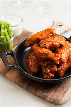 spicy - Dish of chicken wings Stock Photo - Premium Royalty-Free, Code: 614-06336222