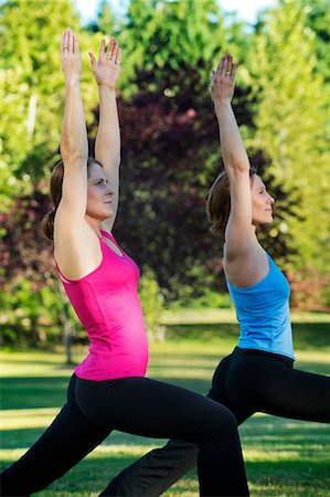 flexible (people or objects with physical bendability) - Two women practising yoga together in a park Stock Photo - Premium Royalty-Free, Code: 614-06336334