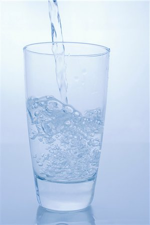 Pouring glass of water Stock Photo - Premium Royalty-Free, Code: 614-06336357