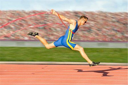 sprint - Runner crossing the finish line Stock Photo - Premium Royalty-Free, Code: 614-06336365