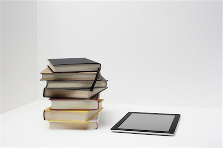 Stack of books with digital tablet Stock Photo - Premium Royalty-Free, Code: 614-06336418