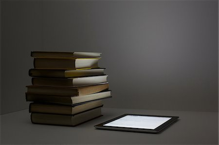 Stack of books with digital tablet Stock Photo - Premium Royalty-Free, Code: 614-06336419