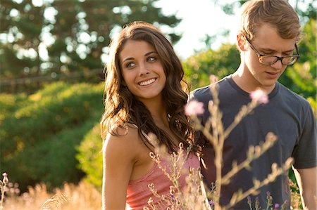 portrait looking away - Couple in field Stock Photo - Premium Royalty-Free, Code: 614-06402529