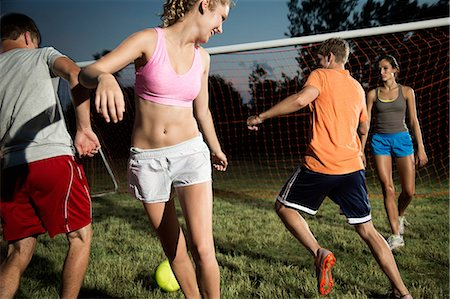 female playing soccer - Friends playing soccer at night Stock Photo - Premium Royalty-Free, Code: 614-06402564