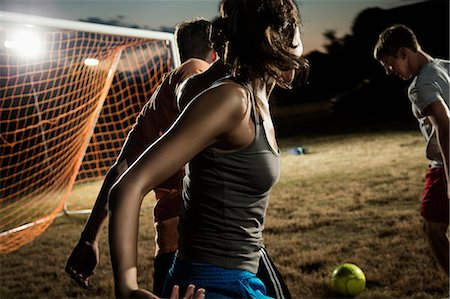 female playing soccer - Friends playing soccer at night Stock Photo - Premium Royalty-Free, Code: 614-06402572
