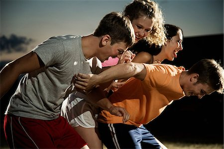 female playing soccer - Friends playing soccer at night Stock Photo - Premium Royalty-Free, Code: 614-06402573