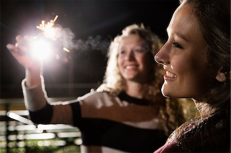 smoke - Friends holding sparkler Stock Photo - Premium Royalty-Free, Code: 614-06402580