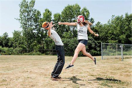 Couple wearing wrestling masks play fighting Stock Photo - Premium Royalty-Free, Code: 614-06402606