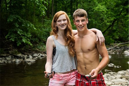 Couple standing by river, portrait Stock Photo - Premium Royalty-Free, Code: 614-06402620