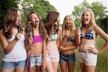 Girls eating ice lollies Stock Photo - Premium Royalty-Free, Code: 614-06402638