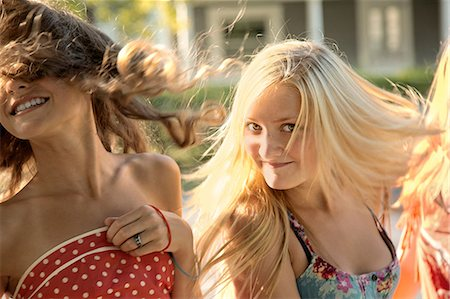 Girls with long hair in sunlight Stock Photo - Premium Royalty-Free, Code: 614-06402667