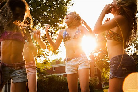 preteen dancing - Girls dancing in garden Stock Photo - Premium Royalty-Free, Code: 614-06402677