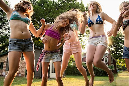 preteen dancing - Girls dancing in garden Stock Photo - Premium Royalty-Free, Code: 614-06402678